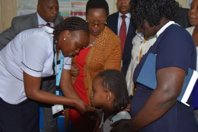 Health Cabinet Secretary Sicily Kariuki witnesses the vaccination a 10 year old girl with HPV vaccine at Othaya Health Centre in Nyeri County on Thursday, October 24.