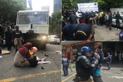 The scenes of a protest outside the UNHCR's offices in Cape Town by refugees seeking the agency's assistance in leaving South Africa over fears of xenophobic violence. Officers forcefully removed demonstrators with several being arrested.