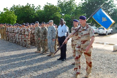 French and Chad military participate in a flag ceremony to commemorate the launch of Operation Barkhane, an anti-terrorist operation in Africa's Sahel region beginning in July 2014.