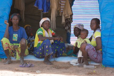 Family members who have fled conflict sit inside their tent at the Pissila camp for displaced people in Burkina Faso (file photo).