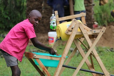 Stephen Wamukota, 9, from Siboti Ward in Bumula, Bungoma County shows how his innovative handwashing machine works.