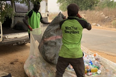 Vicfold Recyclers staff loading plastic waste purchased from women janitors, who collect the waste from the various hostels on the University of Ilorin campus. The week's buy-back of plastic waste will be transported to the Vicfold