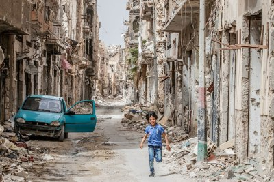 A child runs through the debris and wreckage in downtown Benghazi, Libya (file photo)..