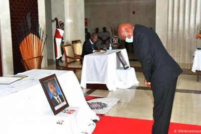 Burundi's opposition leader Agathon Rwasa bowing before a picture of the late President Pierre Nkurunziza.