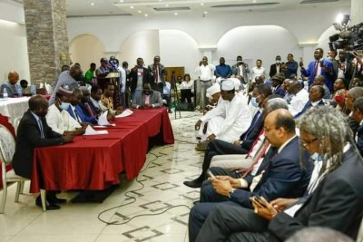 The delegation of the transitional government of Sudan and the armed movements in Darfur sign seven protocols to end the fighting in the region.