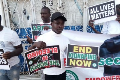 Young Nigerians holding placards at an EndSARS protest (file photo).