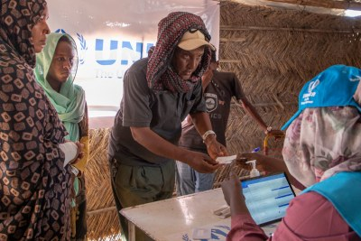 Ethiopian refugees register with UNHCR at Um Rakuba camp in Al Qadarif state, Sudan, after fleeing their home.