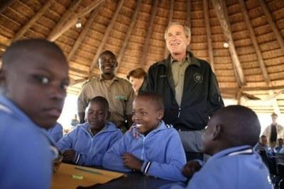 President George W. Bush talks to students attending nature classes at the Mokolodi Nature Reserve near Gaborone, Botswana Thursday, July 10, 2003.