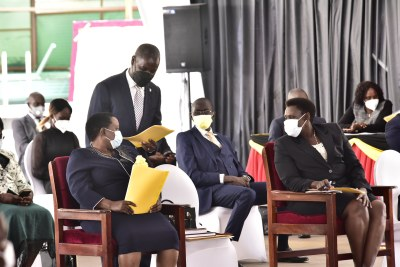 Ruhinda North MP, Thomas Tayebwa consults the Prime Minister designate,  Robinah Nabbanja (left) as the Vice President designate, Jessica Alupo (right) looks on. The House is debating a motion for approval of the vice president.