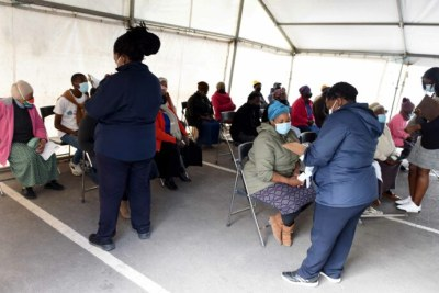 South African healthcare workers assisting residents (file photos).