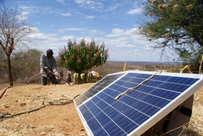 Kaloki Mutwota pumps harvested water from a pond using a solar pump, in Makueni County, Kenya, August 2, 2021.